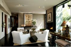 living room with 4-chair arrangement, espresso floors and trim, grass cloth walls, neutrals