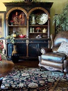 Hutch painted black with gold leaf trim - very Tuscan