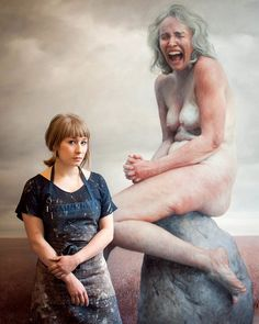 Aleah Chapin (Brooklyn based artist) standing in front of one her paintings which show realistic physiques not typically shown in our society.