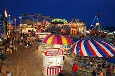 """Seaside Heights Boardwalk at night. For """"Joisee"""" folks, it is """"Going Down The Shore""""  Keansberg, """"The Highlands"""" Seaside, Asbury, Atlantic City, Wildwood, and Cape May are the summer places that New Jersey Folks play in the Sun and Surf."""