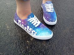 Hand painted galaxy shoes with Taylor Swift lyrics with different writing
