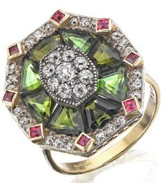 A tourmaline, ruby and diamond dress ring The octagonal plaque set with a central cluster of old round brilliant-cut diamonds, within a surround of eight calibré-cut green tourmalines, to a further surround of single-cut diamonds and square-cut rubies, stamped 18ct,