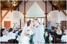 bride and groom kissing leaving the ceremony at whitestone inn
