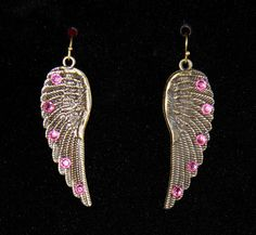 $9.99   Flying in Love Antiqued Gold Wing Earrings with real Swarovski Crystal Rhinestones, check my stuff out at   https://www.etsy.com/shop/GreenEggsandGlam