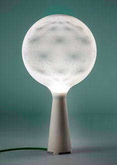 Perforated 3D-printed shades diffuse the glow from lamps in this collection
