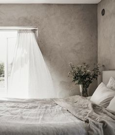 bedroom-with-open-window-and-summer-breeze