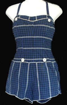 This late 1950s swimsuit from Catalina has several features that were popular in the 1950s. Plaid fabric was popular in the very early 50s, and then again near the end of the decade. Boy legs, which gave the swimsuit the look of a playsuit were also popular.  And the suit has dressmaker touches, such as rick-rack trim and button decoration. Often, these had matching skirts to wear over the swimsuit.