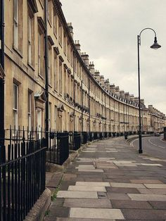 The Royal Crescent, Bath, England The Royal Crescent is a row of 30 terraced houses laid out in a sweeping crescent in the city of Bath, England. Designed by the architect John Wood, the Younger and built between 1767 and 1774, it is among the greatest examples of Georgian architecture to be found in the United Kingdom and is a Grade I listed building.