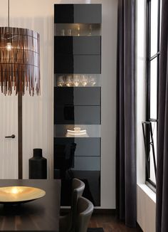 BESTÅ storage combination in black-brown with tempered glass doors