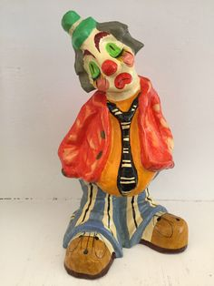 A personal favorite from my Etsy shop https://www.etsy.com/listing/265646676/paper-mache-clown-hand-painted-clown