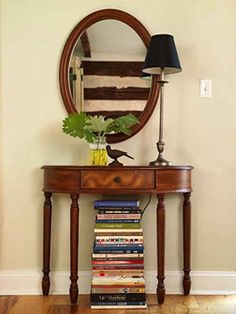 Use an artful stack of books to hide unsightly things like cords or your router.