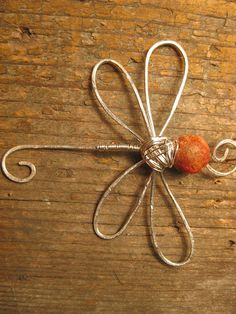 Crossley Design--Sterling silver wire wrapped and hammered dragonfly pendant with fire agate.  https://www.facebook.com/CrossleyDesign?ref=hl