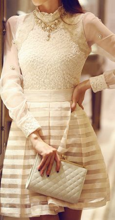 Elegant in white. Lace blouse, striped skirt, quilted clutch and necklace.