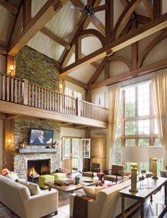 Cypress beams in the family room add a barnlike effect to a Wainscott, New York, residence.