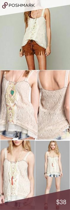 Free People Crochet Maya Beaded Tank Top Small Stunning crochet Beaded tank top. I wore this one time - in great condition. The appliqué ripped from the crochet in one spot (posted a pic). It's a super easy fix, I just never did it because you can't see it when the top is on. Price reflects the cost to have the small rip repaired. Free People Tops