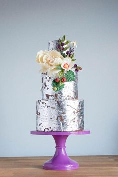 For offbeat brides who like it avant-garde, this #wedding #cake is coated in edible silver leaf.