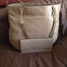 AUTHENTIC MICHAEL KORS BUNDLE Dark dune tote and wallet with gold hardware . In good conditions no stains on the bag but is missing the mk fob .the wallet has one pen scratch on the inside flap and ink stain on out side shown in the 3rd picture other than  that very functional in good condition it holds 8 credit cards and $ bill and coin space with zipper price negotiable  Michael Kors Bags Shoulder Bags