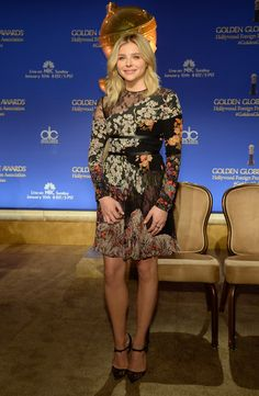 Chloe Grace Moretz totally pulled off clashing prints in this edgy lace-panel patchwork dress by Valentino during the Golden Globe Awards nominations announcement.