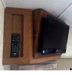 Replaced our old RV TV with a new flat screen. Make an angled panel and mount the tv directly onto it. Use a piano hinge for durability. Gain all the extra space inside the cupboard Rv Tv Mount, Television Mounts, Swivel Tv Stand, Rv Organization, Rv Makeover, Flat Panel Tv, Camper Life, Remodeled Campers, Wall Mounted Tv