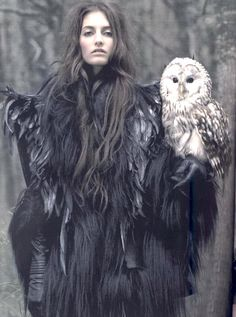 In the woods wearing a goat hair coat, raven feathers, leather gloves and a barn owl too.
