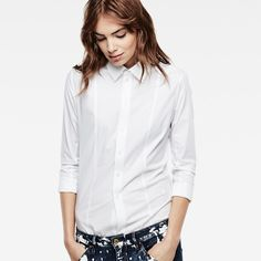 With a slim tailored silhouette, this smart white shirt is an essential addition to every wardrobe.