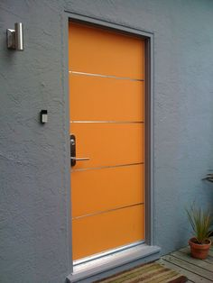 Modern custom front entry - DIY, built this myself - wood door with stainless steel strips., New front entry, wood door with stainless steel strips., Home Exterior Design