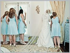 This blue and the wedding dresses lace is just adorable!
