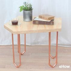 A simple geometric coffee table made of plywood and copper that stands on its own or fits together with others of its like.