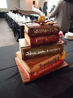 Harry Potter Books Cake! I JUST REALIZED THAT I HAD AN END OF THE WORLD THEMED BIRTHDAY INSTEAD OF AN HP THEMED ONE! I WAS TURNING 17!! IM AND ADULT WITCH!! I PROMISED MYSELF THAT I WOULD HAVE A SNITCH CAKE!! *quietly sobs*