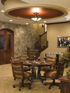 Beautiful high ceilings in the basement with a wine cellar and area for the poker table!