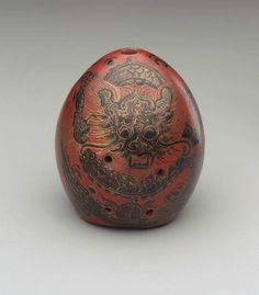 Vessel flute (xun)      19th century       China This is a flute???