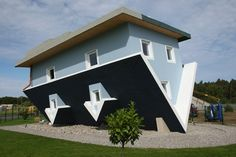 """Klaudiusz Golos and Sebastion Mikuciuk created this upside down house for an exhibit in Trassenheide, Germany. It's clearly unlivable still a lot of fun. """"Crazy Upside Down House in Germany"""" (Thanks, Lindsay Tiemeyer! Architecture Design, Amazing Architecture, Houses In Germany, Upside Down House, Crazy Home, Unusual Buildings, Unusual Homes, Up House, Boat House"""