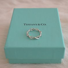 Tiffany & Co. Infinity Ring Delicate yet intricate in composition, this ring possesses a subtle elegance. A beautiful gift for yourself or someone special! Gently used but in excellent condition! Tiffany & Co. Jewelry Rings