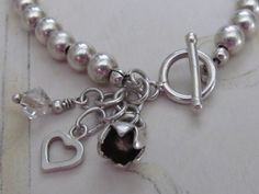 Sterling silver bead bracelet with charm by NikkiHillsDesign