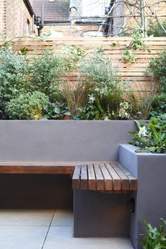 Garden seating. planter box behind. Screened fence. Grey colour