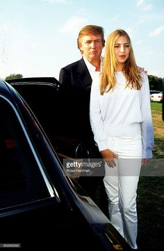 Donald Trump stands with his daughter Ivanka as they attend the Mercede Benz Polo Match at Bridgehampton, Long Island, New York, 1997.