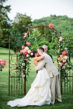 Using vintage garden gates is a brilliant idea for creating your ceremony arch. This Southern wedding's arch is decorated with flowers in sherbet brights, providing an excellent contrast with the weathered metal of the gate.  This arch should definitely become a family heirloom and reside at your home.