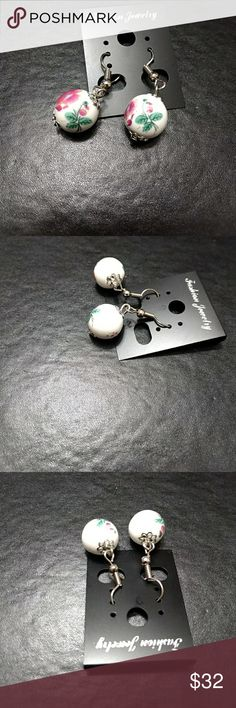 Pretty white round earrings with pink flowers These pretty balls have pink flowers and greenery on them. Jewelry Earrings