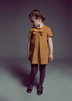 rust dress, i love this! Want to get my mom to show me how to sew and make this for my  6 yr old. Love her braid too.
