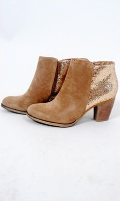 -Desert Sparkle Bootie: Slip into these tan glitter booties and shine your way around town! The front half of the shoe is a soft suede, while the back brings the party with gold glitter! Wood heel and sole. Full zipper on inside. 3