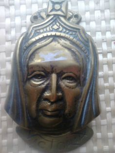 ANTIQUE QUEEN VICTORIA BRASS DOOR KNOCKER....would make me a little timid about entering....
