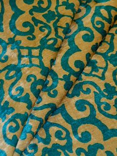 """P Kaufmann Contract Medallion Velvet Chenille  Dark Turquoise on Navajo White Upholstery Fabric  Commercial and Hospitality Grade Closeout from a Manufacturer's Buyout  Fiber: 100% Poyester, flame retardant, backed for upholstery  Width: 55""""  Retail $39.95, special buy, by the yard price $18.95 per yard, for as long lasts, limited quantity, this can not be reordered at this price  #Contractfabric #hospitalityfabric #upholsteryfabric #discountfabric"""