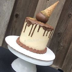 """A custom Melting ""Ice cream"" cone cake. Made with Reese's cake. """