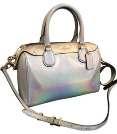 Only one left! Brand new limited time only Coach Hologram Mini Bennett. Has cross body strap. This bag of was released in February 2016 and sold out in three days! Irredescent color changes based on surrounding colors. Wonder piece to wear for spring and summer.