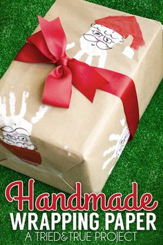 Santa Handprint Homemade Wrapping Paper: Making your own wrapping paper with just paint and a few handprints. Perfect for grandparents!