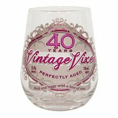 """40 Years Vintage Vixen Milestone Stemless Wine Glass by Oak Patch Gifts. $11.99. Dimensions: Approximately 4 1/2"""" x 2 3/4"""". Holds 14oz. Includes: One 40 Years Vintage Vixen Milestone Stemless Wine Glass. Hand wash with a soft cloth. Design on both sides. Wine label inspired artwork adorns this cheeky stemless 14 oz. wineglass."""