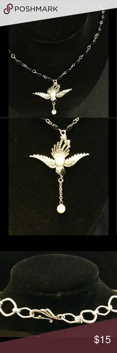 "Diving Bird Necklace Silver metal bird, single Pearl on a chain in his mouth, flying downward on a silver metal and rosary black chain.  10.5"" long , however can be 9"" because you can shorten with the hook.  Bird charm with chain measures 2"".  Sign of fertility and nurturing, a mother bird coming to aide her babies. Tinker made. Jewelry Necklaces"