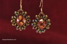 Earrings with olive bronze superduo and orange bicones