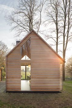 Utrecht Cabin Zecc Architects + Roel van Norel  In the rural area north of Utrecht a compact recreation house has been realized. The house is constructed in wood and opens its façade with window shutters towards the green garden. The design has been realized by a special collaboration between Zecc and interior designer Roel van Norel.