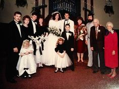 A clean-shavenWillie & permed Korie are beaming on their wedding day. They are surrounded by Willie's brother Alan (who does not appear on the show, butis still close to the family). Alan's wife, Lisa, Jase & Missy on left, & Kay & Phil on right. That's little brother Jep in front. (photo: Robertson family)